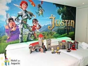 habitación ambientada en una película, con castillos, juegos, dragones